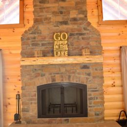 Floor to Ceiling Fireplace with Log Mantle