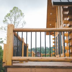 Deck Railing with Square Log Posts and Black Aluminum Spindles