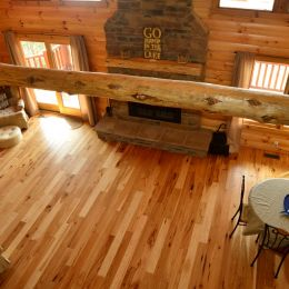 Rustic Hickory Wood Flooring Throughout the Living Room