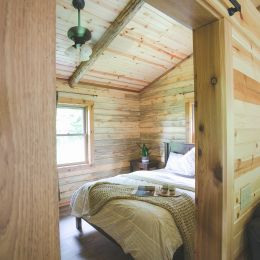 Peek into Master Bath with Surrounding Walls Covered in Tongue and Groove Barn Siding