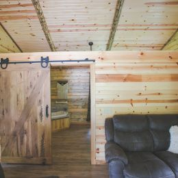 Log Home Interior Wall Covered with Barn Siding