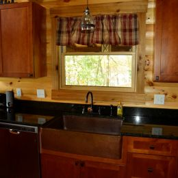Copper Farmhouse Sink in Log Home Rustic Kitchen