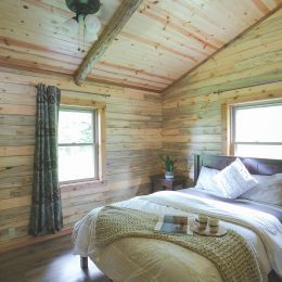Master Bedroom with multiple windows and vaulted ceilings