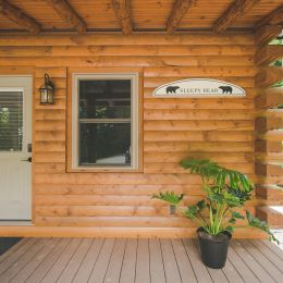 Front Entry of Log Cabin with CCA Porch Flooring