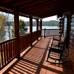 Log Home Porch View with Rocking Chairs