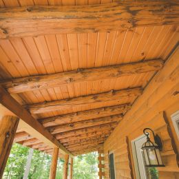 Log Cabin Porch with Rustic Log Supports