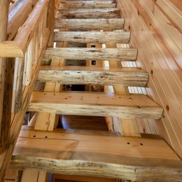 Heavy Timber Log Stairway with Clean Peeled Treads and Railing