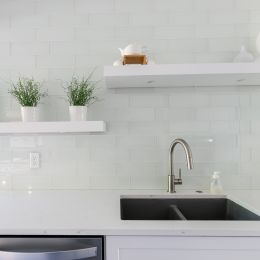 Clear Tile Back Splash in the Kitchen with White Floating Shelves