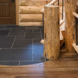 Entryway tile flowing into hardwood flooring