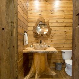 Half bathroom with a custom vanity constructed by The Cabin Store (Mt. Hope, Ohio)