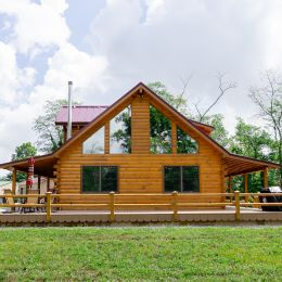 Side View of the Log Home with Double Hung Windows and 4 Trapezoid Windows