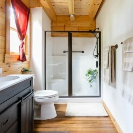 Full Bathroom on the Main Floor with a Clear Shower Door Enclosure