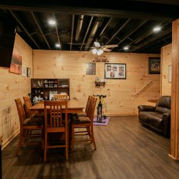 Partially Finished Basement Area with Tongue and Groove Barn Siding on Walls and Black Painted Ceiling