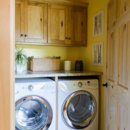 Laundry Room with Cabinets and Countertops