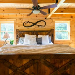 Log Home Master Bedroom with Square Beams On Ceiling