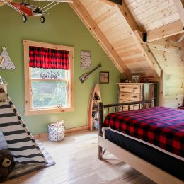Log Home's Upstairs Kid's Bedroom with Wilderness Theme