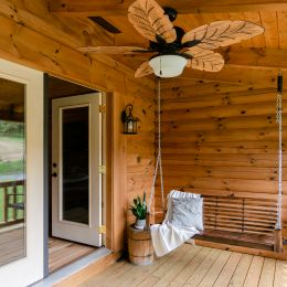 Log Home Porch with Hanging Swing and Ceiling Fan for Warm Nights