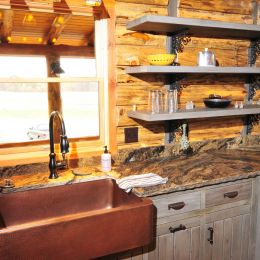 Log Home Kitchen with a Copper Farmhouse Sink