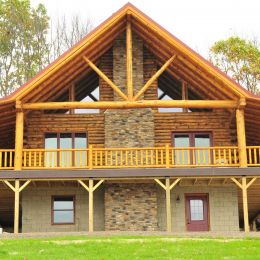 Deco Queen Truss in Log Home Gable