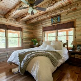 Exterior Round Logs with Rustic Log Joists - Master Bedroom