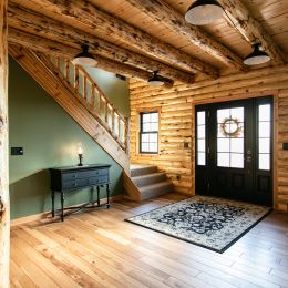 Log Home Foyer with a Conventional Stairway Heading to the Second Floor