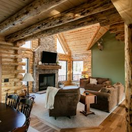 Living Room with a Floor to Ceiling Fireplace and Reclaimed Barn Beam Mantle
