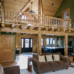 View of the Loft from the Great Room with Rustic Log Railings