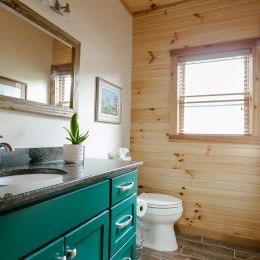 Half Bathroom with a Beautifully Painted Emerald Green Vanity