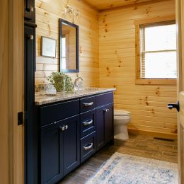 Master Bathroom with Navy Blue Painted Double Vanity