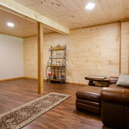 Finished Basement Area with Tongue and Groove Barn Siding on Walls + Ceilings