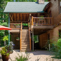 Patio and Porch Off the Back of this Log Home for plenty of outdoor space