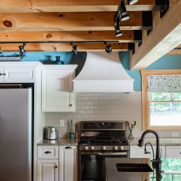 Wooden Vent Hood Above the Stove and Subway Tile Backsplash