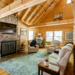 Log Home Great Room with Square Beams and Rafters