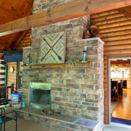 Log Home Outdoor Fireplace to Enjoy on the Back Porch