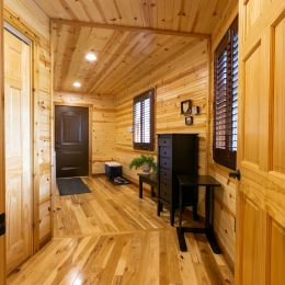 Breezeway showcasing the hickory wood flooring and tongue and groove barn siding on the ceiling