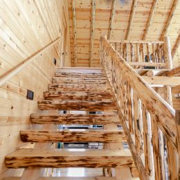 Rustic Log Stairway with Rustic Log Railing