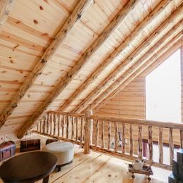 Open Loft Area with Rustic Log Rafters