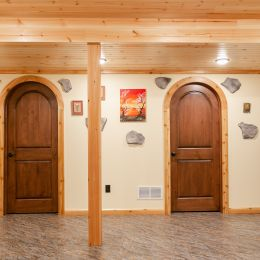 Partially finished basement with arched doors