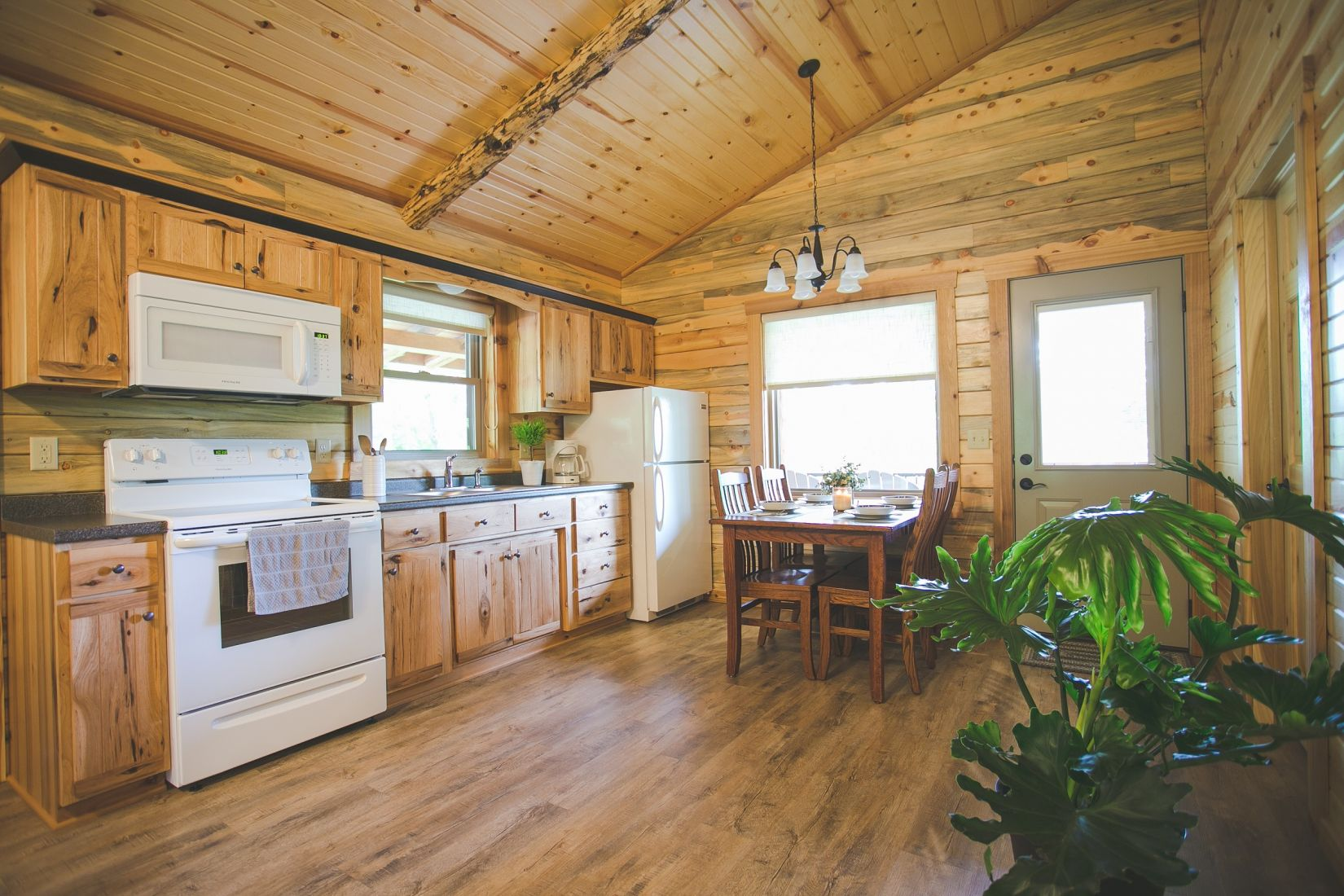 Custom Kitchen Cabinets with White Appliances in Log Home
