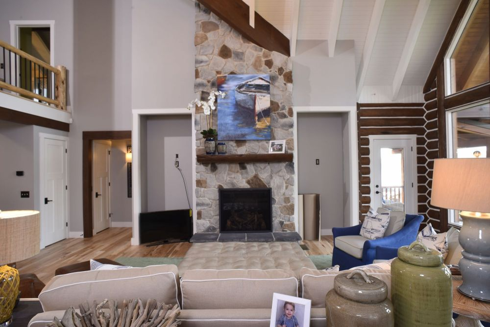 Light Neutral Stone Covered Gas Fireplace