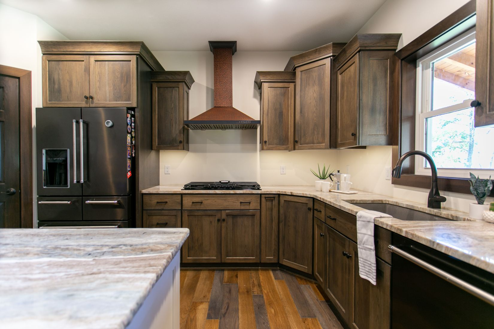 Custom Cabinets with Granite Counter Tops and Copper Stove Hood