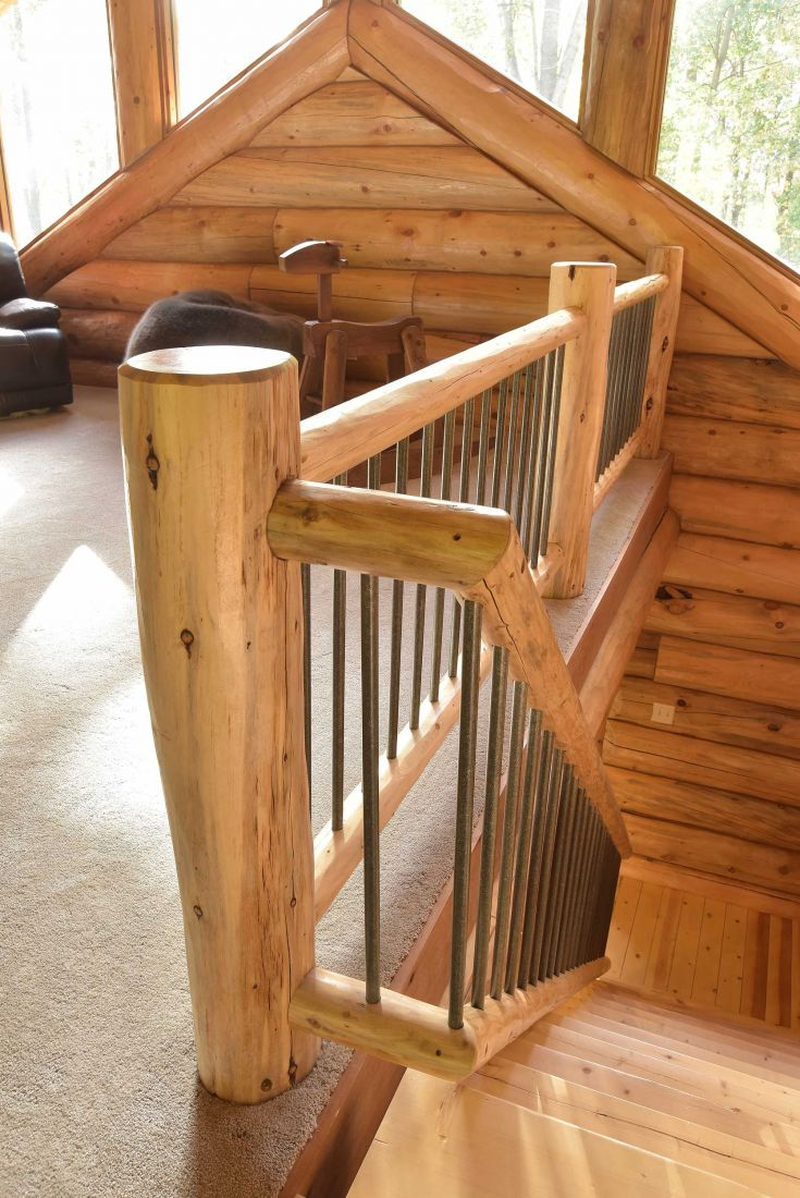 Log stair railing with black aluminum spindles