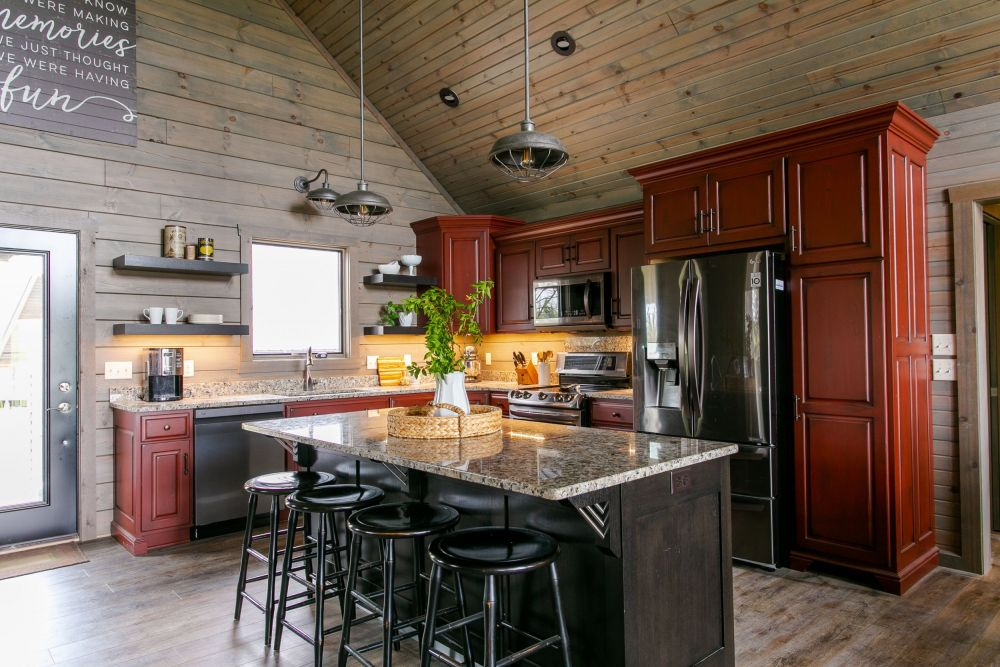 Red Kitchen Cabinets with Brown Island