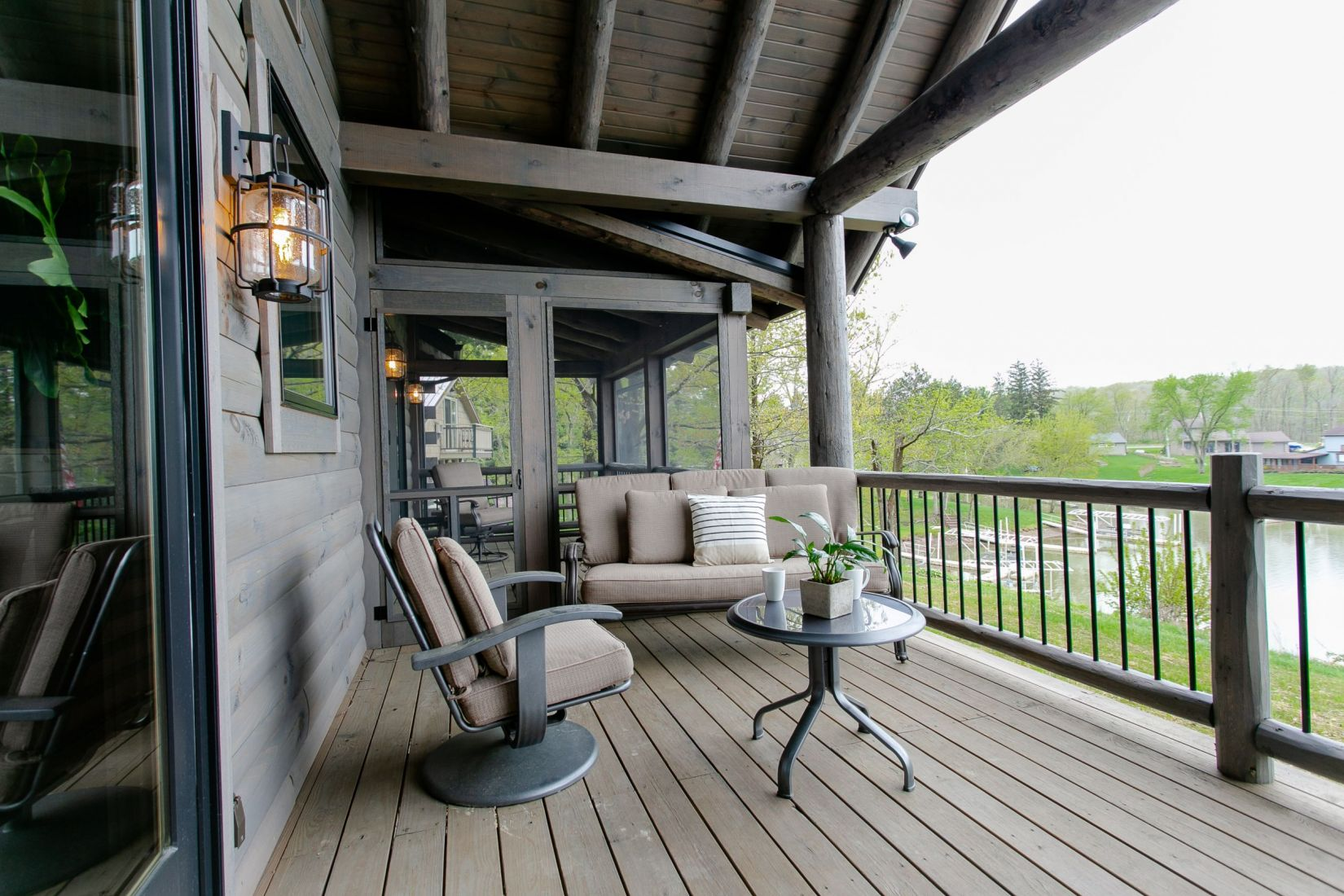 Front Covered Porch Facing the Lake with Industrial Style Light Fixtures