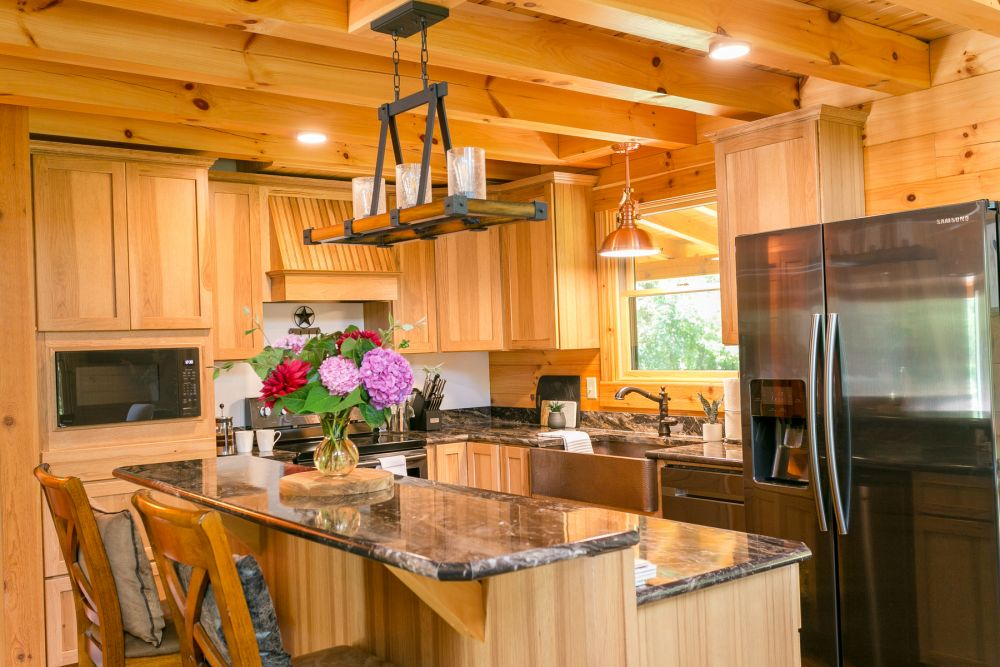 Log Home Kitchen with Center Multi-Level Island