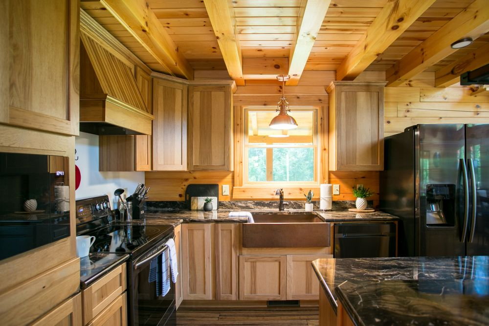 Log Home Kitchen with Copper Farmhouse Sink