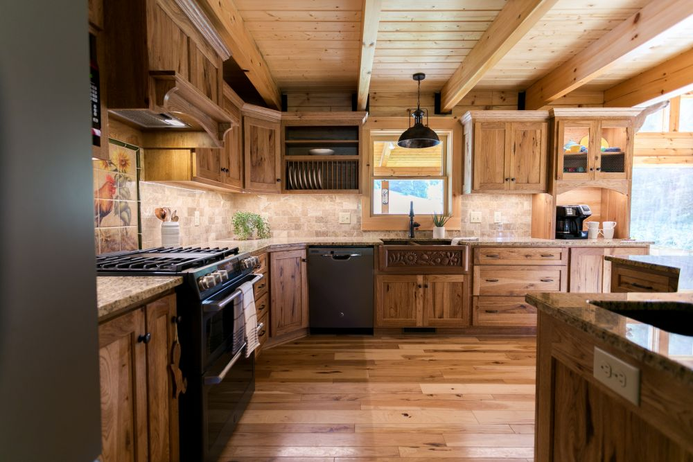 Log Home Kitchen with Imprinted Copper Farmhouse Sink