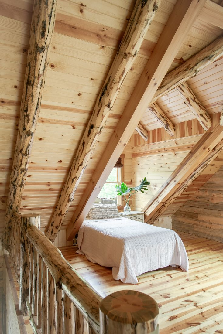 Rustic Log Rafters on top of Tongue and Groove Barn Siding