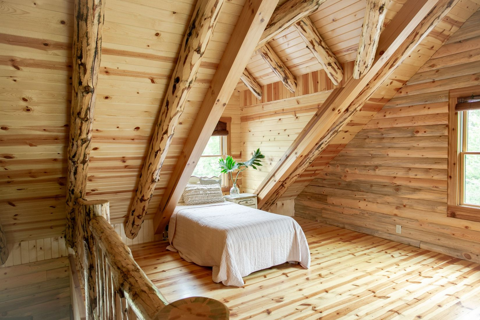 Log Home Loft with Rustic Log Rafters