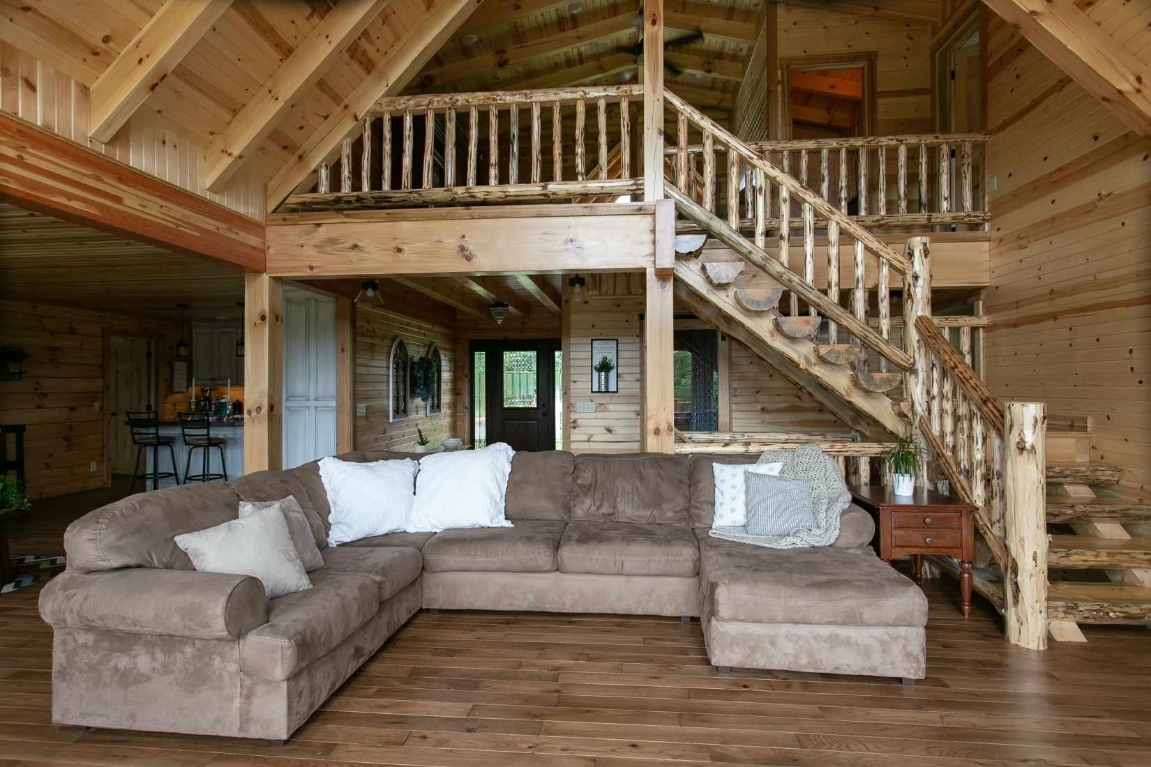 Open Floor Concept with Rustic Log Stairs and Railing
